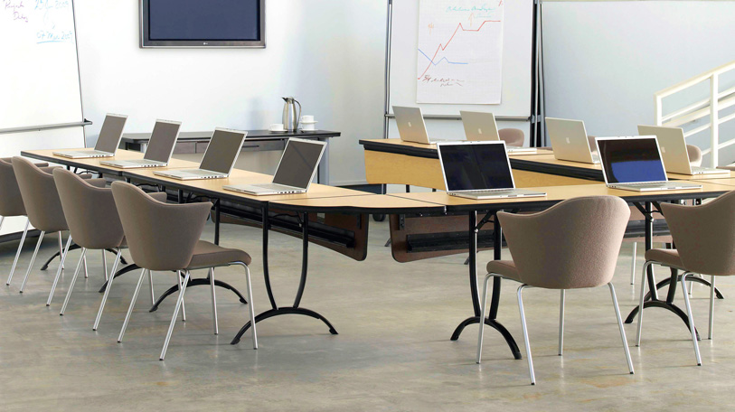 Rizzi Arc tables, shown with the Capa chair by Coalesse, boast details not usually found in such a u
