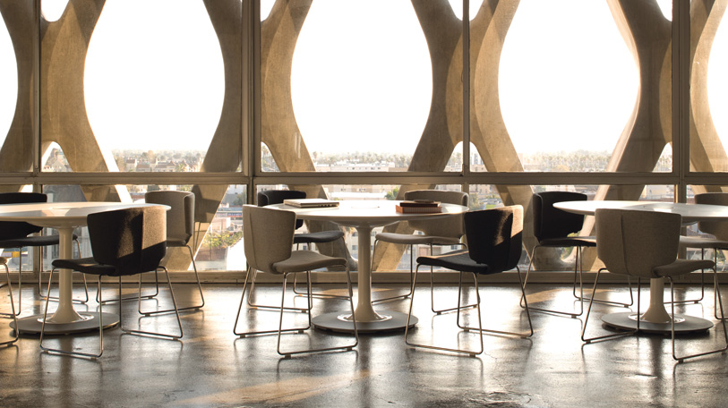 The Wrapp's contemporary design makes a dramatic statement in any setting; shown with Denizen tables